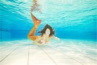 Portrait of Teenage Girl with Mermaid Tail Underwater Stock Photo - Premium Rights-Managednull, Code: 700-08122205