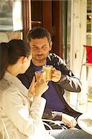 Couple at Outdoor Cafe Having Coffee Stock Photo - Premium Rights-Managednull, Code: 822-08122536