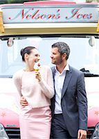 Smiling Couple Standing in front of Ice cream Van Stock Photo - Premium Rights-Managednull, Code: 822-08122568