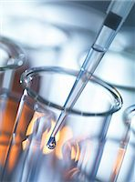 Analytical chemistry, sample being pipetted into a test tube for testing in laboratory Stock Photo - Premium Royalty-Freenull, Code: 649-08126047