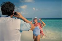 Man photographing senior woman, Maldives Stock Photo - Premium Royalty-Freenull, Code: 614-08126826