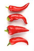 sweet   no people - Close-up of chilli pepper on white background Stock Photo - Premium Royalty-Freenull, Code: 693-08127344