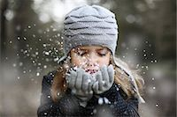 Girl holding snow in her hands Stock Photo - Premium Rights-Managednull, Code: 877-08128948