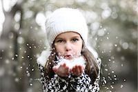 Girl holding snow in her hands Stock Photo - Premium Rights-Managednull, Code: 877-08128949