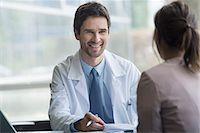 Healthcare worker meeting with patient in office Stock Photo - Premium Royalty-Freenull, Code: 632-08129859