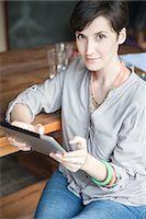 Woman using digital tablet, portrait Stock Photo - Premium Royalty-Freenull, Code: 632-08129997