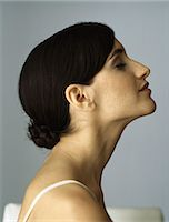 Woman with chignon, eyes closed, profile Stock Photo - Premium Royalty-Freenull, Code: 632-08130104