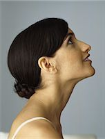 Woman looking up, smiling, profile Stock Photo - Premium Royalty-Freenull, Code: 632-08130105