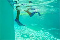 preteen feet - Underwater view of a boy wearing flippers Stock Photo - Premium Royalty-Freenull, Code: 673-08139178