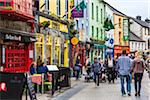 Street scene with pedestrians and stores, Galway, Ireland