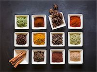 pimento - Various spices in square dishes on a chalkboard surface Stock Photo - Premium Royalty-Freenull, Code: 659-08147053
