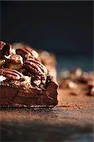 Dark chocolate terrine with pecan nut brittle (close-up) Stock Photo - Premium Royalty-Freenull, Code: 659-08147549