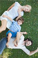 Young family with boy lying together on grass Stock Photo - Premium Royalty-Freenull, Code: 633-08151101