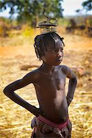 Portrait of girl carrying sandals on her head, near Gaoua, Poni Province, Burkina Faso Stock Photo - Premium Rights-Managednull, Code: 700-08169185