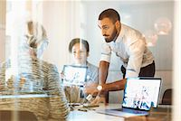 Business people giving presentation to colleague in office Stock Photo - Premium Royalty-Freenull, Code: 698-08171015