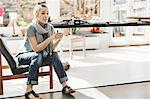 Female architect looking away while sitting on chair in home office