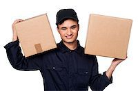 Young delivery boy at work carrying carton boxes on shoulders Stock Photo - Royalty-Freenull, Code: 400-08186477