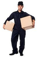Smiling courier guy in blue uniform holding parcels in both hands Stock Photo - Royalty-Freenull, Code: 400-08186481