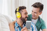 Homosexual couple men listening to music Stock Photo - Premium Royalty-Freenull, Code: 6109-08203558
