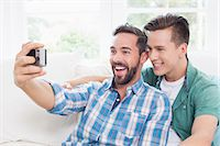 Homosexual couple men taking a selfie Stock Photo - Premium Royalty-Freenull, Code: 6109-08203570