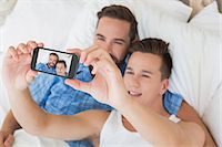 Happy homosexual taking a selfie Stock Photo - Premium Royalty-Freenull, Code: 6109-08203713