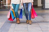 shopping mall - Women holding shopping bags Stock Photo - Premium Royalty-Freenull, Code: 6109-08204145