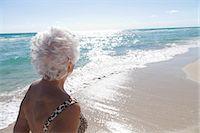 Senior Woman on the beach Stock Photo - Premium Royalty-Freenull, Code: 6122-08211844