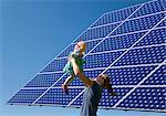 Woman and daughter by solar panel