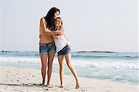 preteen kissing - Mother and daughter hugging on a beach Stock Photo - Premium Royalty-Freenull, Code: 6122-08212664