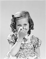 smelly - 1940s LITTLE GIRL BLOWING HER NOSE WITH CLOTH HANDKERCHIEF Stock Photo - Premium Rights-Managednull, Code: 846-08226048