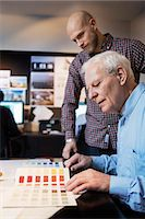 Businessmen choosing color from swatch in office Stock Photo - Premium Royalty-Freenull, Code: 698-08226306