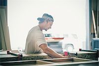 Side view of carpenter making furniture in factory Stock Photo - Premium Royalty-Freenull, Code: 698-08226717