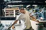 Carpenter making furniture at workshop