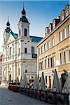 Street scene with Church of the Holy Spirit and restaurant patio, Old Town, Warsaw, Poland.