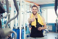young man near weight training equipment in sport gym Stock Photo - Royalty-Freenull, Code: 400-08263414