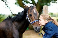 preteen kissing - Girl horseback rider kissing horse Stock Photo - Premium Royalty-Freenull, Code: 614-08270370