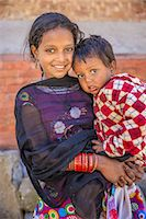 Young Nepali girl with her little brother Stock Photo - Premium Royalty-Freenull, Code: 6106-08277797