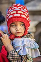 Nepali baby carrying by mother Stock Photo - Premium Royalty-Freenull, Code: 6106-08277853