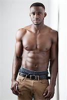 Men's Fitness, dark skinned model on white background Stock Photo - Royalty-Freenull, Code: 400-08296078