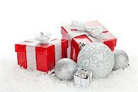 silver box - Christmas baubles and red gift boxes over snow with copy space Stock Photo - Royalty-Freenull, Code: 400-08298071