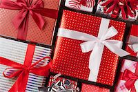 silver box - Christmas gift boxes on wooden table. Top view closeup Stock Photo - Royalty-Freenull, Code: 400-08299760