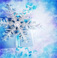 silver box - Beautiful Christmas present, elegant festive still life, gift box wrapped in silver paper decorated with shiny snowflake over blurry background Stock Photo - Royalty-Freenull, Code: 400-08303531