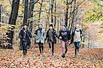 Girls running in autumn forest