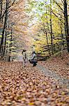 Mother and daughter in autumn forest