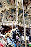 Vintage carousel or merry-go-round. Black Horse detail