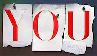 Cut out letters, YOU, pinned to wall Stock Photo - Premium Royalty-Freenull, Code: 600-08353484