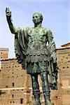 Statue S.P.Q.R. IMP.CAESARI NERVAE Augustus on street Via dei Fori Imperiali, Rome, Italy
