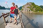 Couple taking self portrait, using selfie stick and smartphone, Cat Ba Island, Halong Bay, Vietnam