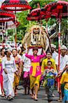 People carrying Sacred Barongs in a parade at a temple festival in Petulu Village, near Ubud, Bali, Indonesia