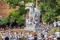 People carrying a raised, white bull character in a parade at a cremation ceremony for a high priest in Ubud, Bali, Indonesia Stock Photo - Premium Rights-Managednull, Code: 700-08385899